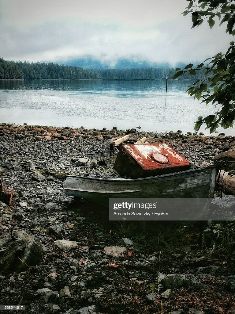Red Box On Old Boat At Beach : Stock Photo