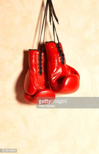 red boxing gloves hanging - pair stock pictures, royalty-free photos & images