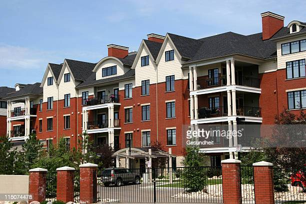red brick condos - complicated stock photos and pictures