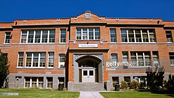 red brick high school building exterior - secondary school stock pictures, royalty-free photos & images