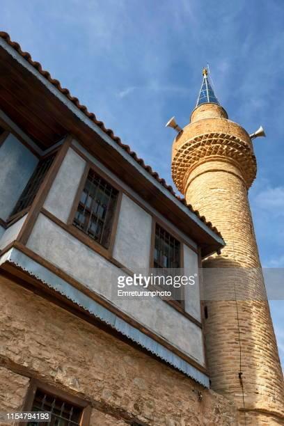 red brick minaret and upper floor of a house in buldan,denizli province. - emreturanphoto stock-fotos und bilder