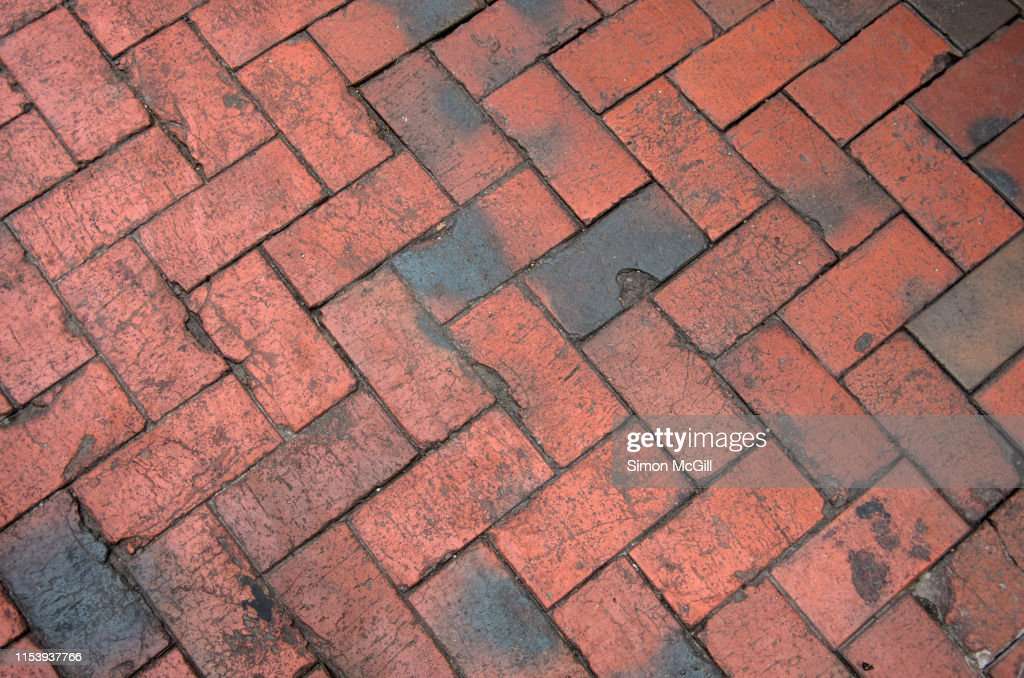 Red Brick Paving In A Herringbone Pattern High Res Stock Photo