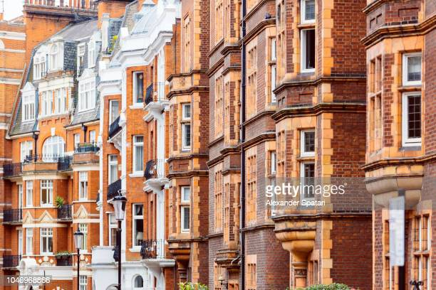 Red brick Victorian houses in Kensington and Chelsea district, London, UK