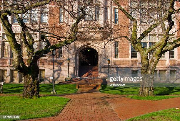 red brick walkway in front of university educational building - high school building stock pictures, royalty-free photos & images