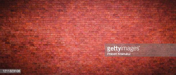red brick wall background - ladrillo fotografías e imágenes de stock