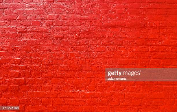 red brick wall background - rood stockfoto's en -beelden