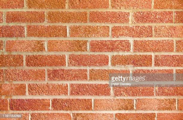 red brick wall close up - wall building feature stock pictures, royalty-free photos & images