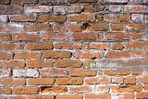 Red brick wall texture and pattern. Full frame image in vibrant color.