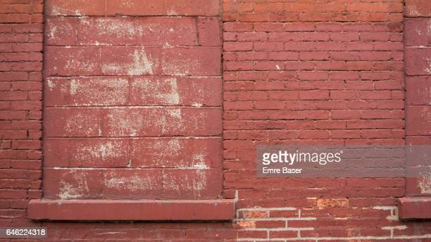 Red brick wall with blocked window