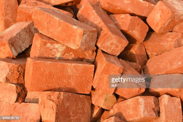 red bricks - construction material stock pictures, royalty-free photos & images