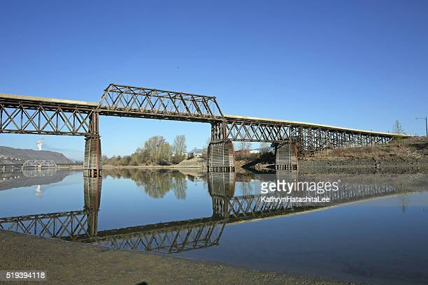 red bridge over south thompson river, kamloops, british columbia - kamloops stock pictures, royalty-free photos & images