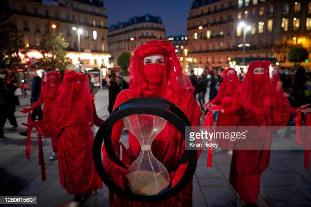 Red Brigade Extinction Rebellion demonstrators, representing the blood of extinct species, hold a theatrical 'die in' to denounce the French...