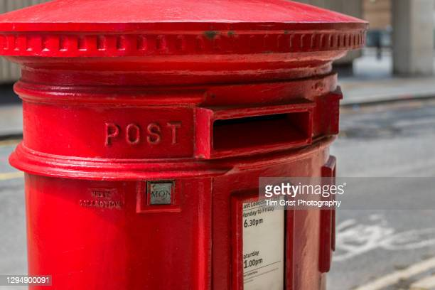 red british post box in an empty london street - message stock pictures, royalty-free photos & images