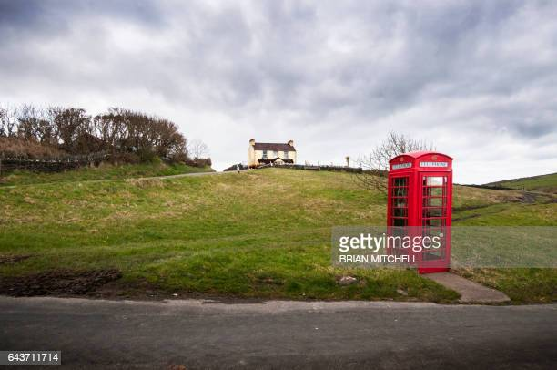 red british style telephone box in a country setting - isle of man stock pictures, royalty-free photos & images