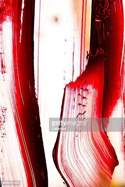 Red brush stroke on white background