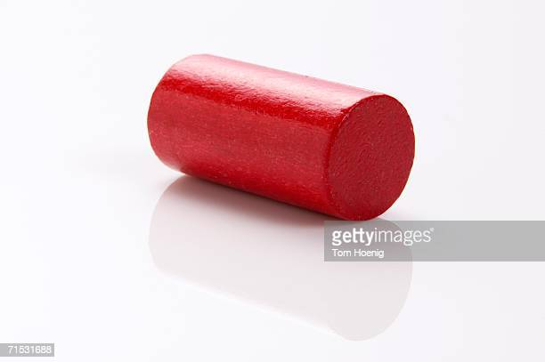 Red building block, cylinder, close-up