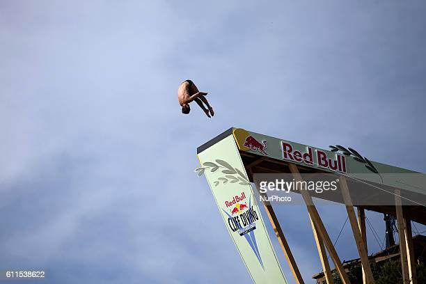Red Bull Cliff Diving World Series 2011 Lake Vouliagmeni Athens Greece May 22 2011 The divers jump from a 28m cliff and their descent lasts about 3...