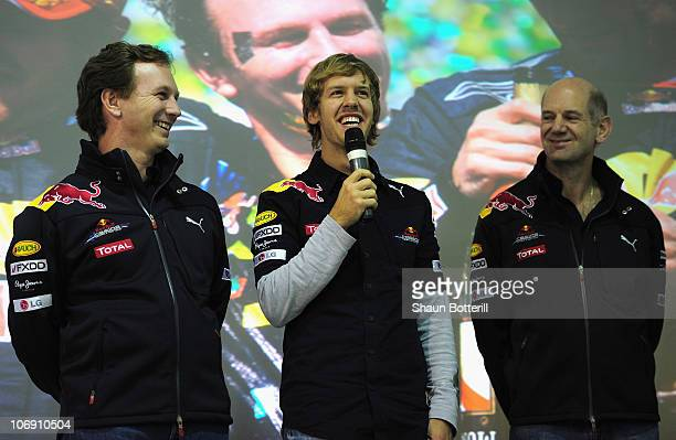 Red Bull driver and Formula One World Champion Sebastian Vettel Chief Technical Officer Adrian Newey and Team Principal Christian Horner talk to the...