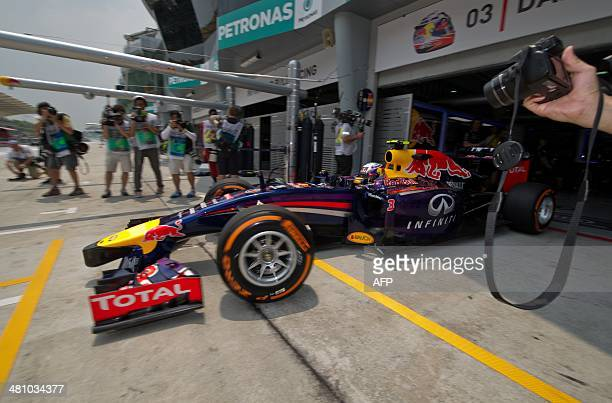 Red Bull driver Daniel Ricciardo of Australia leaves the pit during the first practice session ahead of the Formula One Malaysian Grand Prix in...