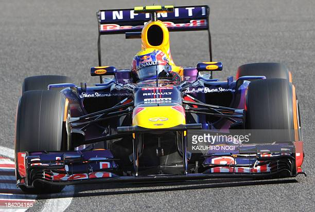 Red Bull driver Mark Webber of Australia drives his car during the qualifying session ahead of the Formula One Japanese Grand Prix in Suzuka on...