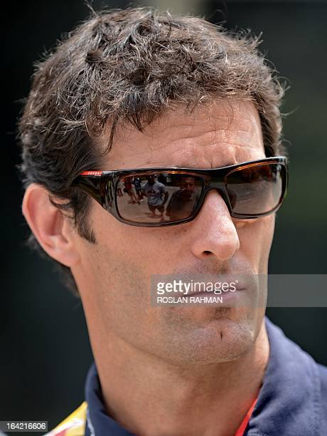 Red Bull driver Mark Webber of Australia is seen along the paddock ahead of the Formula One Malaysian Grand Prix at Sepang on March 21, 2013. The...