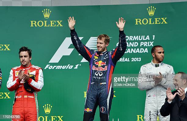 Red Bull driver Sebastian Vettel of Germany celebrates his win in the Canadian Formula One Grand Prix at the Circuit Gilles Villeneuve in Montreal...