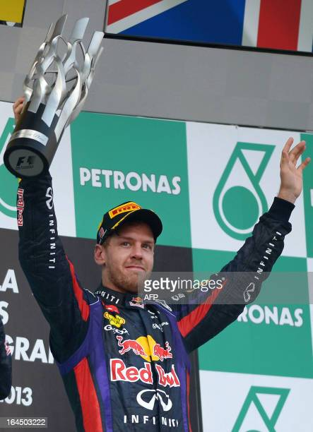 Red Bull driver Sebastian Vettel of Germany celebrates on the podium after winning the Formula One Malaysian Grand Prix in Sepang on March 24 2013...