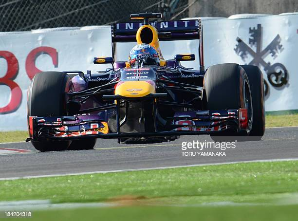 Red Bull driver Sebastian Vettel of Germany drives his car during the qualifying session ahead of the Formula One Japanese Grand Prix in Suzuka on...