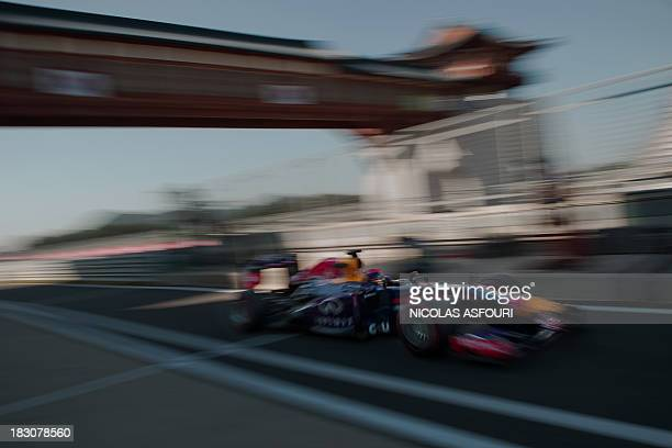 Red Bull driver Sebastian Vettel of Germany drives his car into the pit lane during the first practice session of the Formula One Korean Grand Prix...