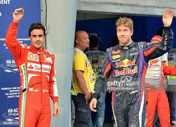 Red Bull driver Sebastian Vettel of Germany in pole position and Ferrari driver Fernando Alonso of Spain in third wave to the crowd after the...