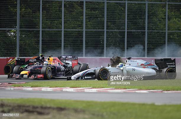 Red Bull driver Sebastian Vettel of Germany passes by as Williams driver Felipe Massa of Brazil and Force India driver Sergio Perez of Mexico crash...