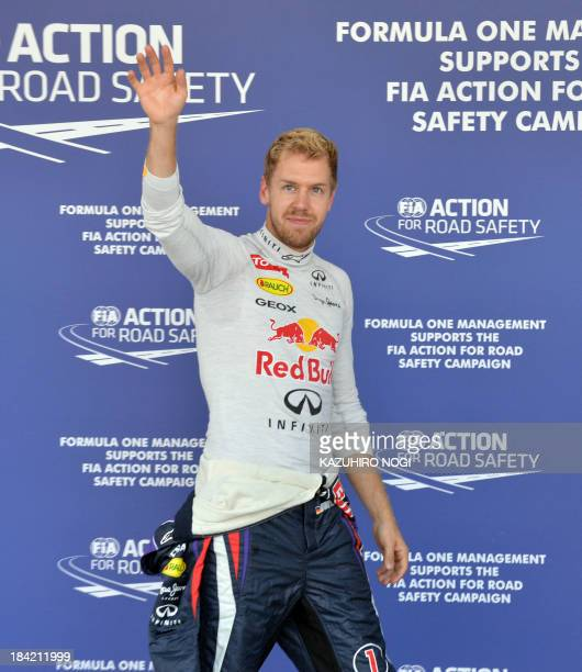 Red Bull driver Sebastian Vettel of Germany waves after the qualifying session ahead of the Formula One Japanese Grand Prix in Suzuka on October 12,...
