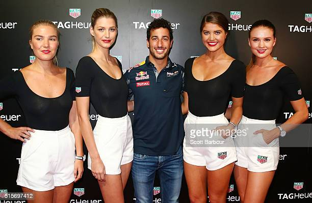 Red Bull Formula 1 Team driver Daniel Ricciardo poses with models at the TAG Heuer Grand Prix Party at Luminare on March 15 2016 in Melbourne...