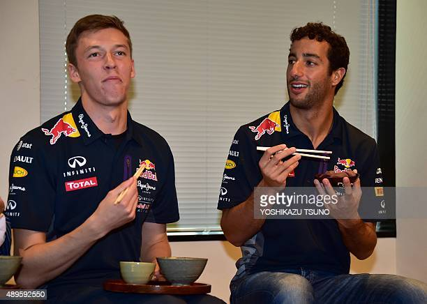 Red Bull Formula One team drivers Daniil Kvyat of Russia and Daniel Ricciardo of Australia taste Japanese green tea and mochi wrapped in sweet...