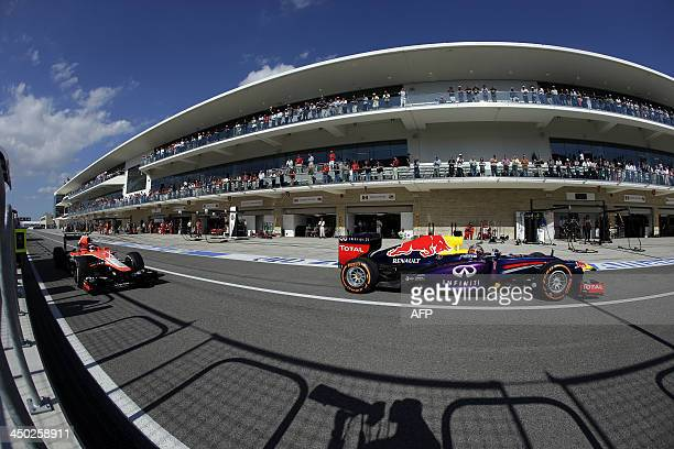 Red Bull German driver Sebastian Vettel races out of the pits during the United States Formula One Grand Prix at the Circuit of The Americas on...
