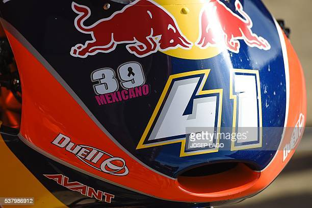 Red Bull KTM Ajo Moto3 South African rider Brad Binder's motorbike sports a sticker as a tribute for SAG Team Moto2's Spanish rider Luis Salom at the...