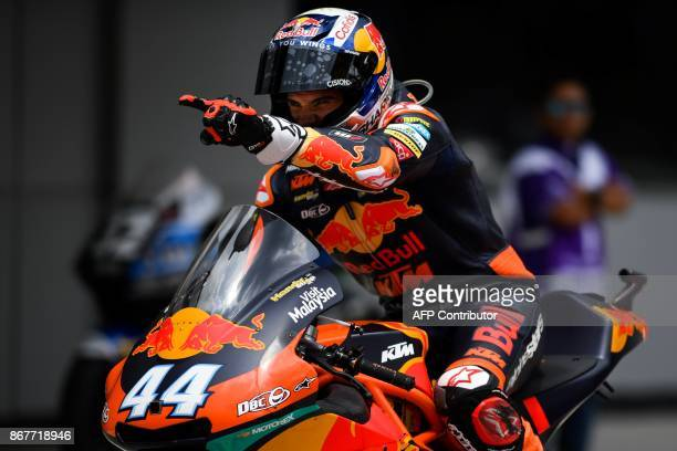 Red Bull KTM Ajo rider Miguel Oliveira of Portugal celebrates after winning in the Moto2class at the Sepang International Circuit in Sepang on...