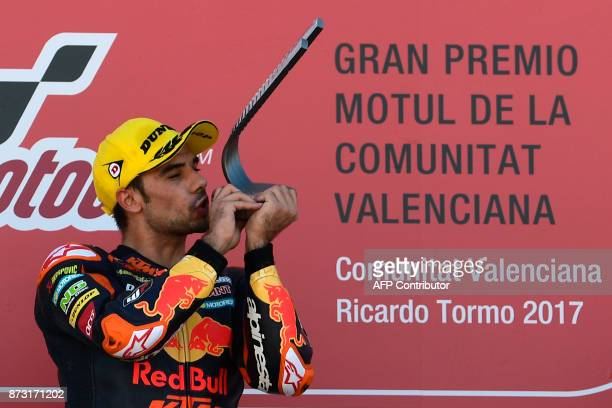 Red Bull KTM Ajo rider Miguel Oliveira of Portugal celebrates his victory on the podium after winning the Moto2 race of the Valencia Grand Prix at...