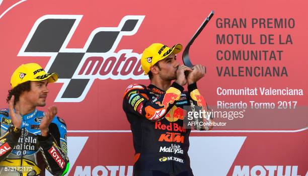 Red Bull KTM Ajo rider Miguel Oliveira of Portugal celebrates his victory on the podium with secondplaced EG 00 Marc VDS rider Franco Morbidelli of...