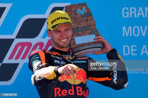 Red Bull KTM Ajo´s South African rider Brad Binder celebrates on the podium after winning the Moto2 race of the Moto Grand Prix of Aragon at the...