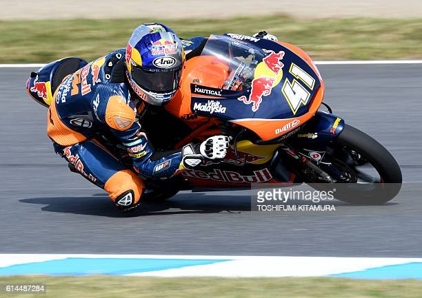 Red Bull KTM Ajo's South African rider Brad Binder drives his motorcyle during the Moto3class second free practice session at the Japanese Grand Prix...