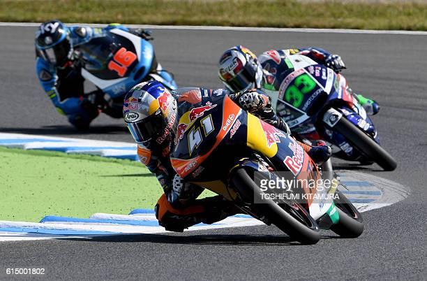Red Bull KTM Ajo's South African rider Brad Binder leads Gresini Racing Moto3's Italian rider Enea Bastianini and SKY Racing Team VR46's Italian...
