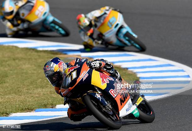 Red Bull KTM Ajo's South African rider Brad Binder leads RBA Racing Team's Argentine rider Gabriel Rodrigo and RBA Racing Team's Italian rider...