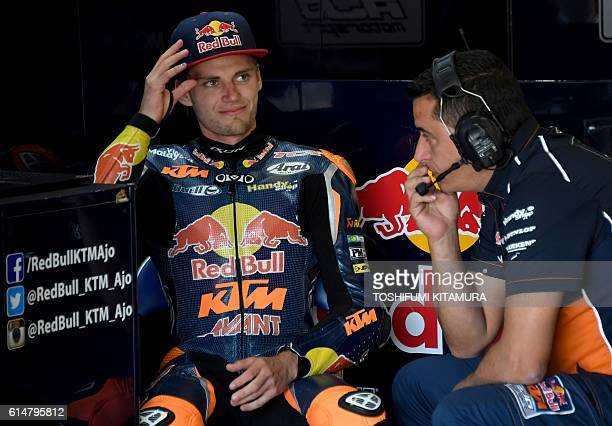 Red Bull KTM Ajo's South African rider Brad Binder listens to his team officer during the Moto3class qualifying session at the Japanese Grand Prix in...