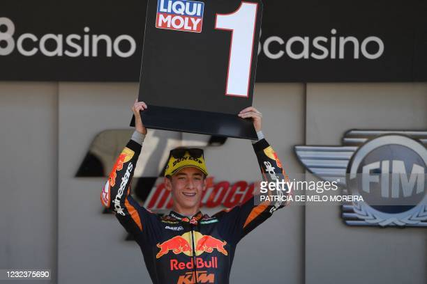 Red Bull KTM Ajo's Spanish rider Pedro Acosta celebrates after winning the Moto3 race of the Portuguese Grand Prix at the Algarve International...