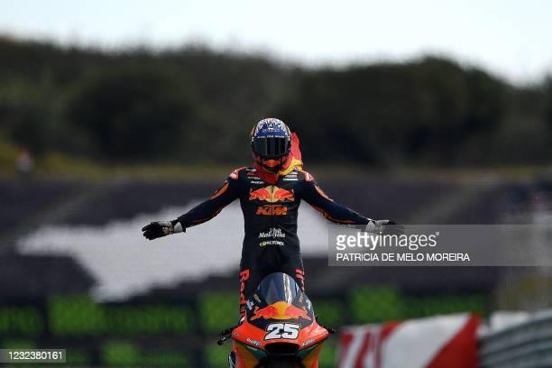 Red Bull KTM Ajo's Spanish rider Raul Fernandez celebrates after winning the Moto2 race of the Portuguese Grand Prix at the Algarve International...