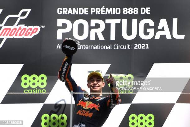 Red Bull KTM Ajo's Spanish rider Raul Fernandez celebrates on the podium after winning the Moto2 race of the Portuguese Grand Prix at the Algarve...