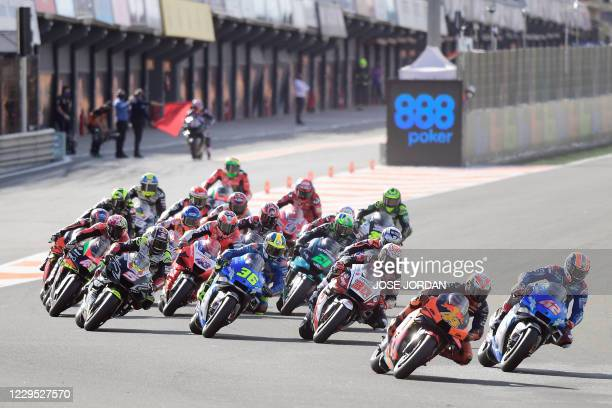 Red Bull KTM Factory Racing's Spanish rider Pol Espargaro leads at the start of the MotoGP race of the European Grand Prix at the Ricardo Tormo...