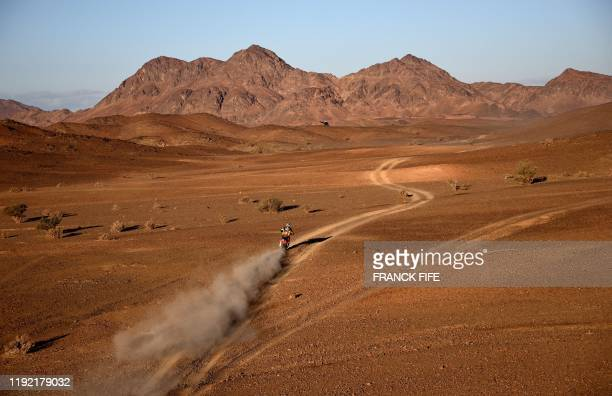 TOPSHOT Red Bull KTM Factory Team's Matthias Walkner of Austria rides his KTM 450 Rally motorbike during the Stage 2 of the Dakar 2020 between Al...