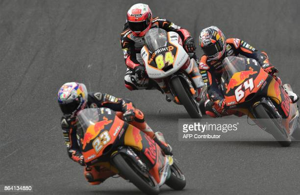 Red Bull KTM rider Niccolo Antonelli of Italy leads Red Bull KTM rider Bo Bendsneyder of Netherlands and Peugeot rider Jakub Kornfeil of Czech...